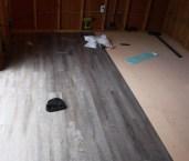 Peel-and-stick vinyl plank.